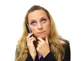 Thoughtful young businesswoman using mobile phone — Foto Stock
