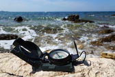 Holiday destination concept with Compass on sea — Stockfoto
