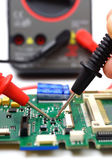 Engineer is checking electronic component — Stock Photo