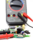 Multimeter and electronic spare components isolated on white bac — Stock Photo