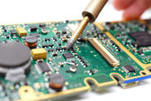 Electrical Engineer is soldering on printed circuit board — Stock Photo