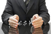 Businessman's protecting investment in currency — Stock Photo