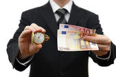 Time is money concept with businessman with money and pocket wat — Stock Photo