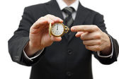 Elay or late concept with businessman showing pocket watch — Stock Photo