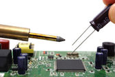 Solder the capacitor on the motherboard — Stock Photo