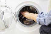 Handyman repairing a washing machine — Stock Photo