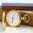 Pocket watch with old books — Stock Photo