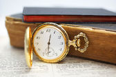 Pocket watch with old books — Stok fotoğraf