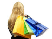 Beautiful woman with a lot of shopping bags. Isolated on white,  — Stock Photo