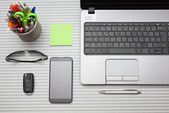 Modern office desk with working accessories, top view — Stock Photo
