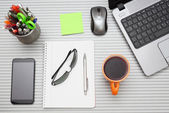 Office desk with laptop with business accessories and cup of tea — Stock Photo