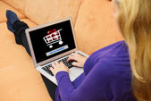 Woman Using Laptop With Online Shopping Application On A Screen — Stock Photo