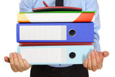 Businessman carrying binders — Stock Photo