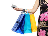 Closeup of picture of woman with shopping bags and credit card — Stockfoto