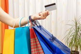 Woman with  shopping bags bought with a debit or credit card at  — Stock Photo