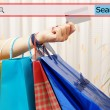 Girl showing shopping bags with search bar. Concept of on line s — Stock Photo #51505987