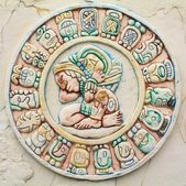 A stone carving of mayan symbols — Stock Photo