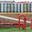 Fire hydrant water pipe in front of lpg gas bottles - Stock Photo
