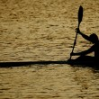 Stock Photo: Canoeing at dusk
