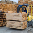 Fork lift truck in wood factory — Stock Photo #18212875