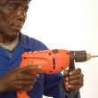 Construction Worker Working with Power Tool — Stock Photo #18214373