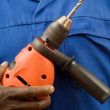 Stock Photo: Construction worker holding a power tool