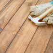 Hammer, nails and plank on table — Stock Photo #18216419