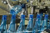 Water bottle production machine — Stock Photo