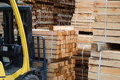 Fork lift truck in wood factory — Stock Photo