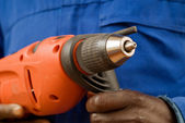 Construction worker holding a power tool — Stock Photo