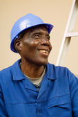 Happy Construction Worker Resting on Ladder Steps — Stock Photo