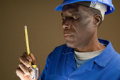 Construction Worker with Measuring Tool — Stock Photo