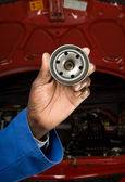 Mechanic and oil filter — Stock Photo