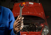 Mechanic and spanner — Stock Photo
