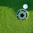 Golf ball and hole — Stock Photo #18227863