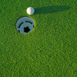 Stock Photo: Golf ball on next to hole 4