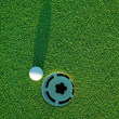 Golf ball on next to hole 3 — Foto de Stock