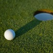 Stock Photo: Golf ball on next to hole 2