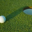 Golf ball on next to hole 1 — Stock Photo