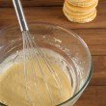 Pancake mixture and cakes — Stock Photo
