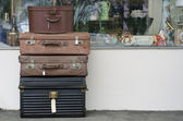 Old suitcases outside antique store — Stock Photo