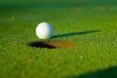 Golf ball on next to hole 5 — Stock Photo