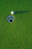 Golf ball on next to hole 4 — Stock Photo