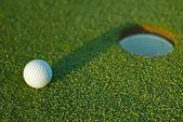 Golf ball on next to hole 1 — Stock Photo