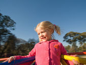 Happy girl in park play ground — Stock Photo