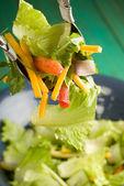 Tossing salad — Stock Photo