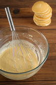 Pancake mixture and cakes — Stock Photo