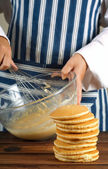 Flapjacks or pancakes and whisking mixture — Stock Photo