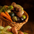 Thanksgiving basket filled with autumn fruits and vegetables. - Stock Photo