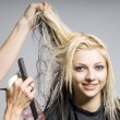 Hairdresser cutting hair — Stock Photo